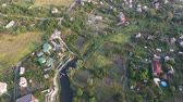 taşra : Beautiful aerial view of suburban on the sunny summer day. Fly over old houses in the countryside. Village landscape from above. Stok Video