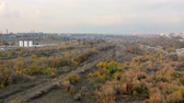 Aerial top view from the drone of empty single-way railway without train at autumn in suburb among trees.