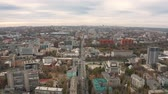 4K Drones eye view of city skyline. Cityscape with downtown buildings. Flying over street in Dnipro city in Ukraine.