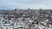 Fly up over cityscape of Dnipro city at winter. 4K Urban aerial view from drone on downtown with buildings. (Dnepr, Dnepropetrovsk, Dnipropetrovsk). Ukraine. Стоковые видеозаписи