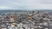 4K Urban aerial view from drone on cityscape with buildings at winter. Flying over downtown in Dnipro city in Ukraine.