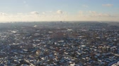 Aerial view of winter cityscape in Dnipro city. 4K footage from drone of city landscape with skyline. (Dnepr, Dnepropetrovsk, Dnipropetrovsk). Ukraine.