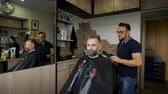 noivo : Cozy Barbershop, is engaged in a professional stylist haircut men aged. A respectable businessman in the clients chair.