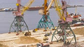 shipped : Industrial port area. Crane with bucket loads mortar sand in the truck. Stock Footage