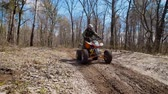 all terrain vehicle atv : Extreme vacation in the woods on the ATV. Men engage in motor sport, quad bike is an ideal means for riding on country roads. All wheel drive helps to overcome obstacles, and to conquer the terrain