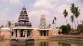резной : Clouds passing on South Indian Temple background with pond