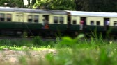 бедность : Passenger train passing from India.