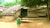 pobre : unidentified little Indian girl comes on towards camera. Stock Footage