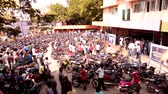 sinema : Bike parking at cinema theater, First day movie release peoples waiting in line for the public Cinema theater in India.