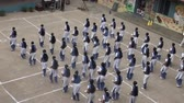 okula geri : Students Performance At School Ground exterior shor Stok Video