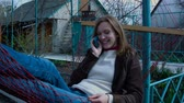 reclináveis : Lying in a hammock Girl talking on the phone Stock Footage