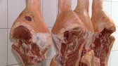 butchered : Pork meat hanged on a hooks in a butchery HD