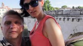 Couple making mobile photo of Tiberius bridge landmark Rimini Italy. Kiss Stock Footage