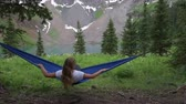 Girl rests on a Hammock looks at Dallas Peak near Lower Blue Lake Ridgway Colorado Stok Video