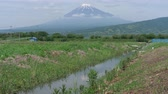 irrigation : Mt. Fuji over an Irrigation Channel in the Countryside of Japan