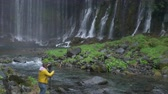 世界遺産 : A Man Shooting Landscape photograph at Hiraito Falls in Fujinomiya City, Shizuoka Pref., Japan 動画素材