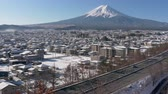 Япония : Mt. Fuji over the Highways and Snowy Town (pan)