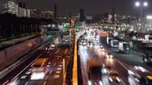 entrare : Time-lapse Video of Highway Traffic in a Big City (Zoom In)