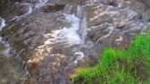 denge : Clear water flowing down a series of rock steps