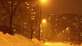 nevando : Snow falling hard in the city during the first snowstorm of 2013  Stock Footage