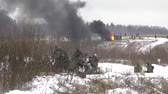 bojiště : RUSSIA, LIZLOVO - DECEMBER 12: Unidentified German soldiers kill Russians on reenactment of the counterattack under the Moscow in 1941 in World War II, in Moscow region, Lizlovo village, Russia, 2015 Dostupné videozáznamy