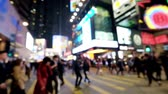 életmód : Slow motion video of people moving at crossroad in crowded evening city street. Hong Kong. Blur effect Stock mozgókép