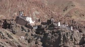 showplace : Beautiful view of ancient Basgo monastery or Bazgo Gompa against rocky mountain slope on background. Picturesque mountainous landscape with religious buildings. Ladakh, India. Camera zooms out. Stock Footage