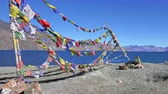 himalaia : Spectacular scenery with colorful Buddhist prayer flag garlands waiving in wind against Pangong Tso lake and Himalaya mountains. Sacred religious place surrounded by mountainous terrain. Ladakh, India