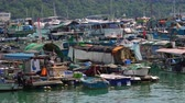 aberdeen : HONG KONG - OCT 27, 2017: Boats and yachts swaying on waves. Floating village. Historical place and popular touristic landmark. Aberdeen harbor, Hong Kong.
