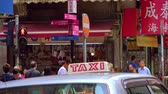 hongkong : HONG KONG - NOV 4, 2017: Traditional shops or convenience stores selling local goods with lots of signboards, crowds of people, traffic lights and driving taxi cabs on modern Asian city street. Dostupné videozáznamy