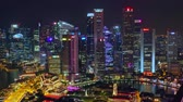 fullerton : SINGAPORE - OCT 19, 2017: Fantastic night view of Singapore city center with beautiful historical buildings illuminated by colorful lights against river and Marina Bay Financial Centre on background.