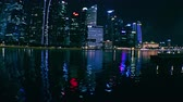 megalopolis : SINGAPORE - OCT 20, 2017: Fantastic night view of Asian city with tall futuristic buildings and skyscrapers with window lights reflecting in rippling water. Beautiful cityscape modern megalopolis