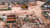 hard drive : SINGAPORE - OCT 19, 2017: Top panoramic or aerial view of urban construction site with cranes unloading trucks and hard hat workers. Work of heavy equipment vehicles or machines. Time lapse Stock Footage