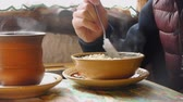 aveia : In The Morning Girl Eats Oatmeal Porridge In The Ethnic Cafe.