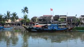 Traditional boat moored on the river in the ancient town of Hoi An, Vietnam.