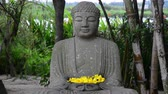 Stone statue of Buddha in the garden