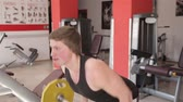 fitness : The man raises the bar in the gym Stock Footage