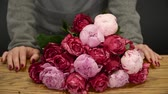 kwiaciarnia : Bouquet of red roses and pink peonies