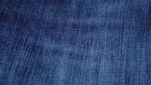 синий : Blue denim jeans texture. Jeans background. Top view. Стоковые видеозаписи