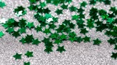 fotografický : Sparkling glitter in the shape of a star. Close-up on a silver background