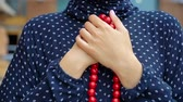 Muslim woman praying with islamic beads in hand, religious meditation, worship