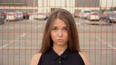Portrait of a girl on the background of the grid Stock Footage