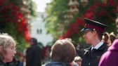 Копенгаген : COPENHAGEN - September 2017 - Uniformed assistant helps direct people outside Tivoli Park, Copenhagen