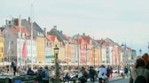 Дания : COPENHAGEN - September 2017 - Colorful buildings and tourists at the Nyhavn Waterfront in Copenhagen, Denmark