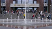 borough : Adults and children near the fountain. Theater of the young spectator. Russia, Saratov, June 1, 2017