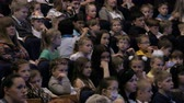 carefully : Spectators watch the show or view in the theater. Children and adults alike. Clip footage in 4K. Theater of the young spectator. Russia, Saratov, June 1, 2017