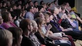 tranquilo : Spectators watch the show in the theater. People in the audience. Na Strastnom Theater Center. Russia, Moscow, 8 September 2016 Stock Footage