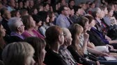 sakin : Spectators watch the show in the theater. People in the audience. Na Strastnom Theater Center. Russia, Moscow, 8 September 2016 Stok Video