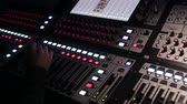 The work of the sound engineer behind the mixing Desk at the concert Stok Video
