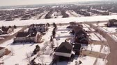 krajobraz : Aerial of homes in a snow covered suburban neighborhood Wideo